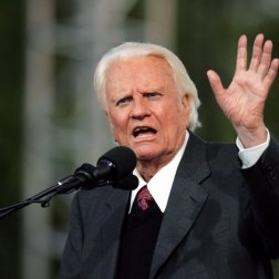 UNITED STATES - JUNE 25: The Rev. Billy Graham, 86, delivers his sermon to a crowd of about 80,000 on the second day of the Greater New York Billy Graham Crusade at Flushing Meadows-Corona Park in Queens. The three-day long event may be the ailing evangelist's last U.S. crusade. (Photo by Michael Appleton/NY Daily News Archive via Getty Images)